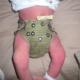 Как выбрать первые подгузники для новорожденного?