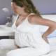 Почему болит поясница при беременности, и что делать?