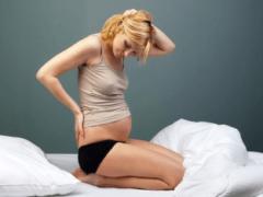 Причины боли в копчике при беременности